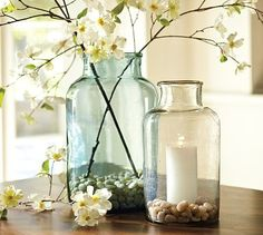 Display blooming branches in antique vessels.