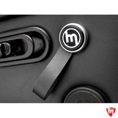 The vintage version of the door pulls features single loop real leather pull held with high quality aluminum CNC machined two piece cap with mirror polished vintage Mazda logo. Two versions are available - with silver or black upper holder cap. Comes as pair with all necessary fixings. Last, but not least, as functionality and added value are equally important to us as design - these door pulls won't interfere with the leg room of even tallest drivers.