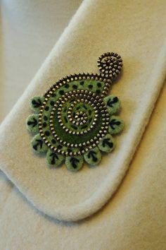 Felt and zipper paisley brooch.