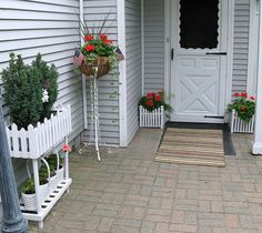 white door with white planters by sunshinesyrie, via Flickr
