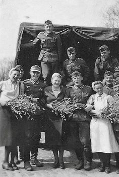 A happy scene of DRK nurses with Wehrmacht veterans