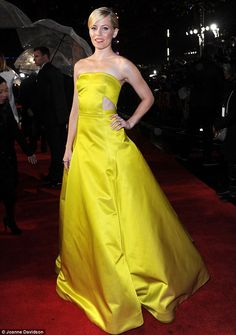 Mellow yellow: Elizabeth Banks lights up a gloomy night in a Jason Wu gown at the UK premiere of The Hunger Games: Catching Fire