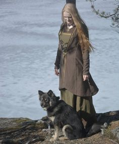 Viking woman and her most loyal friend. http://saewulf.tumblr.com/
