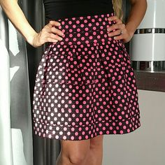 💗'VALENTINE' 💗Gorgeous pink polka-dot skirt. NWT 💋Honored Host Pick💋 Brand new with tags.  Rows of black elastic with vibrant pink polka dots all over. Pair with a black top, blazer and heels or with a playful white top and booties with a denim jacket.   Zipper detail in back  Stretchy material. Overall length 18 inches  80% polyester 20% elastic   Skirts A-Line or Full