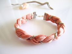 Pale Peach- Coral Fiber Bracelet- Braided Peach Dyed Tshirt Cotton with Silver and gold Sparkle Yarn. $18.00, via Etsy.