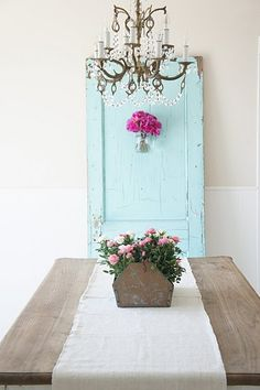 Love the farmhouse table and pop of color