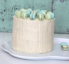 Blueberry and lemon cake with white chocolate frosting and mini macarons on top :-) Great for a baby shower