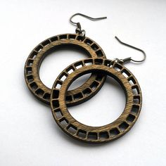 Hoop Earrings - Decorative  With a unique design, these hoops are a bit more decorative than your classic hoop. They are made from Birch wood and are designed using simple geometric shapes and proportions. Fun and light weight, you can wear these all day, everyday. Great for those with sensitive ears.  Sizes: 1.75 inches in diameter  Your choice of: Fish Hooks - black gunmetal earwire Leverbacks - black gunmetal earwire made of alloy metal (lead, cadmium & nickel free) * all fish hook ear...