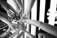 bride bridesmaids holding hands detail Destination wedding reception Hyatt Ziva Cancun Sky Terrace