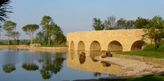 Arches support a curved bridge on the Mesa Vista Ranch in Roberts County, Texas. See more at: http://chambersarchitects.com/blog/231-the-endurance-of-the-roman-arch.html And read all of our blog articles at: http://chambersarchitects.com/blog.html