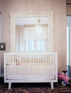 (originally from Lonny Mag) Love the oversized mirror behind the crib, and the rug is fabulous too!