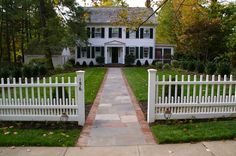 love the trees & white picket fence