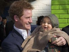 Harry looked like a natural as he held young children at the kindergarten at the Sagrada Familia kindergarten June 2014 Prince William Family, Prince William And Harry, Prince Henry, William Kate, Prince Harry And Meghan, Prince And Princess, Princess Of Wales, Harry And Meghan Wedding, Prince Harry Of Wales