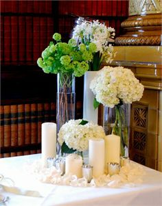 spring group of hyacinths, narcissi, guelder rose with petals and candles