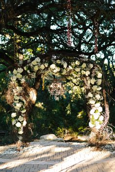 Gorgeous floral and sparkle wedding arch | Twilight Metallic Glam Wedding At Sacred Oaks at Camp Lucy Texas | Photograph by Al Gawlik Photography  http://storyboardwedding.com/twilight-metallic-glam-wedding-sacred-oak-camp-lucy-texas/