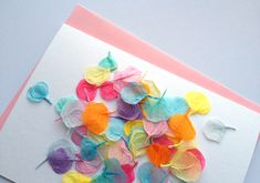 Making bright, colorful petals from tissue paper. Great for cards, decor, etc!