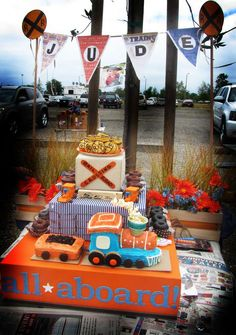 Jude's turns 3 Choo Choo | CatchMyParty.com vintage train cake table and pennant banner with railroad crossing signs
