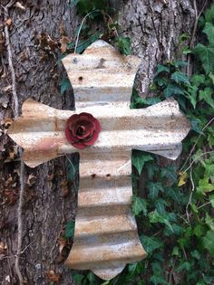 Cross cut from barn tin and embellished with tin rose.