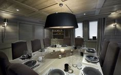 Elegant Formal Dining Room Table Sets Ideas With Giant Black Chandelier Above The Light Wood Dining Table And Brown Fabric Chairs At Chalet White Pearl