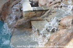 Spill over waterfall with natural stone in a hand carved waterfall. Michigan Custom Hybrid Swimming Pool,