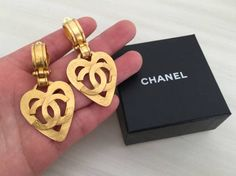 PLEASE READ THE BELOW DESCRIPTIONS CAREFULLY. YOU MAY CLICK ZOOM UNDER THE PICTURES TO SEE MORE DETAILS. -100% Authentic Chanel. -Classic vintage 1995 CHANEL CC logo heart dangle clipped on earrings. -These are currently quite rare in the market and in good vintage condition. -Matte gold tone and look hammered texture (please refer to the 2nd and 3rd pictures). -Large size, beautiful, lovely, attractive and unique! -There are imperfections such as stain/dirt, dents and scuffs/scratc...