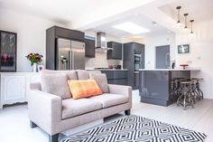 Id have dropped ceilingover the working area to take eye off the beamsMonochrome Rug, Grey Internal Doors Kitchen Seating, Kitchen Layout, Kitchen Ideas, Open Plan Kitchen Living Room, Open Plan Living, Grey Internal Doors, Glossy Kitchen, Kitchen Diner Extension, Kitchen Skylights