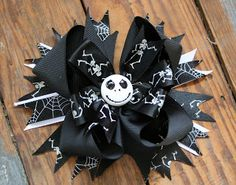 Halloween is just around the corner and we have a few bows left in stock. One of my favorites is this Jack Skellington XL Boutique bow. Jack Skellington, Disney Hair Bows, Halloween Hair Bows, Rainbow Loom Charms, Ribbon Sculpture, Boutique Hair Bows, Bow Hair Clips, Girls Hair Accessories, Cute Bows