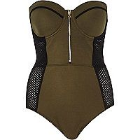 Prove that a full costume is every bit as stylish as a two-piece in this chic khaki and black swimsuit. Featuring a mesh insert waist with tummy control, molded cups and detachable straps. Our model wears a UK 8 and is 175cm/5'9'' tall.