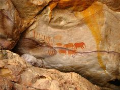 San rock art (Bushmen of the Kalahari) is just about as old as it gets, and there have been interesting studies paralleling it with the great European cave art (great read: The Mind in the Cave).