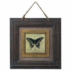 """Wood-framed print of a butterfly.  Product: Framed wall artConstruction Material: WoodColor: Burnt oak and antique blue frameFeatures: HandcraftedDimensions: 18"""" H x 14"""" W x 0.75"""" D"""