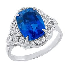 4.19 Carat No Heat Sapphire Diamond Ring. This platinum ring centers a GIA certified cushion cut Sri Lanka sapphire weighing 4.19ct. that has no indication of heat treatment. The mounting is enhanced with sparkling round cut diamonds weighing approximately 0.50ct. 21st century