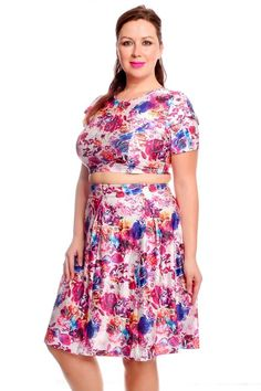 This two piece set features a multi color floral print crop top and skater skirt.   Cotton Spandex Polyester  Model Info: Height: 5ft 10in | Waist: 37in | Hips: 36.5in | Chest: 38DD Wear Size: XXL