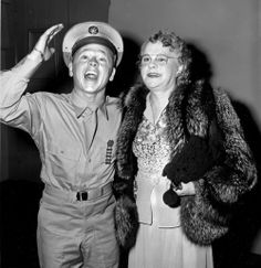 Pvt. Mickey Rooney attends a Hollywood movie premiere with his mother, Nell Pankey, in 1944. The actor is back in Hollywood after completing 3 months of basic training at Fort Riley, KS. (AP Photo)