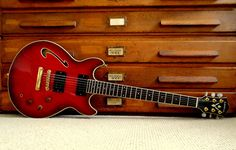 "Washburn HB50.  William McKraken sent in these two lovely shots of an elusive Washburn he is lucky enough to own, but we'll let him tell you more about it;  ""A legendarily rare guitar among Washburn enthusiasts. Apparently they made around 50 of them around '89-'90 in Japan. This one is #38. It's a semi-hollow mahogany body with a maple top, two humbuckers, a glued neck and it sounds incredible and plays beautifully. If you find one, buy it!  Beautifully made and finished with gold hard"