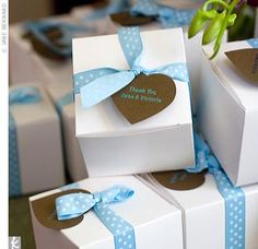 handmade, heart-shape lavender sachets made from pale blue silk that were packaged in white boxes tied with blue and white polka-dot ribbon.