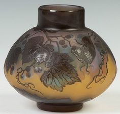 IMAGE: An early 20th Galle art glass vase decorated with grape leaves in amber to blue on a mauve ground