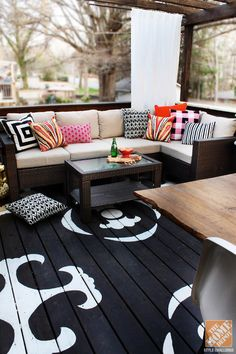 Kristin gave her back deck a total overhaul by painting the floor with a black-and-white graphic pattern, building a pergola, and piling her Hampton Bay Beverly Sectional with comfy outdoor throw pillows!