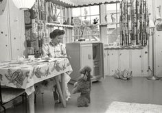 """Los Angeles circa 1952. """"Actress Betty White at home with her dog."""" Note what looks like an Emmy Award atop the television set. Photos by Maurice Terrell and Earl Theisen for Look magazine."""