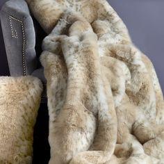 Faux lynx fur throw.  Product: ThrowConstruction Material: Acrylic and velvetColor: Lynx