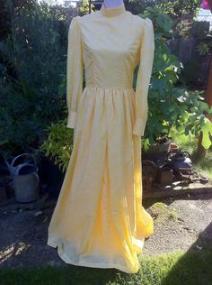 A personal favorite from my Etsy shop https://www.etsy.com/uk/listing/247609292/1970s-yellow-flower-maxi-brides-maid