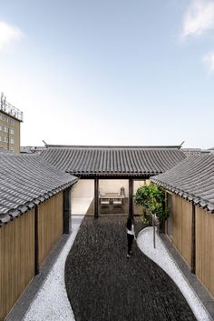 Good wood - Beijing based Arch Studio renovated a traditional courtyard house in the Chinese capital, adding grey-brick paving that flows from the floor of the outdoor space to form internal walls and. Architecture Courtyard, Japanese Architecture, Space Architecture, Contemporary Architecture, Chinese Courtyard, Chinese Buildings, Brick Paving, Courtyard House, Japanese House