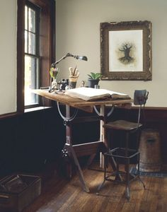 drafting table in front of a window for a well lit creative workspace | interior design + decorating ideas