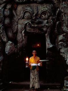 A woman at Goa Gajah (Elephant Cave) in Bali, Indonesia.