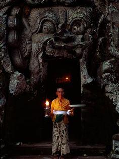 A woman at Goa Gajah (Elephant Cave) in Bali, Indonesia.
