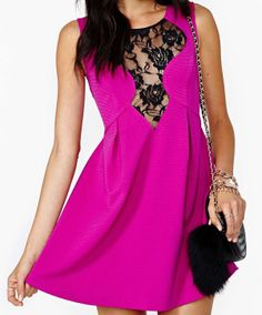 Pink dress with black lace detail.