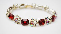 Red Rhinestone Tennis Bracelet - Aurora Borealis crystal - Gold tonemetal - Mid Century