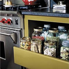 Slide-out drawers built in the space vacated by the old dishwasher, keep dry goods neatly organized and handy near the range. | Photo: Sara Essex | thisoldhouse.com