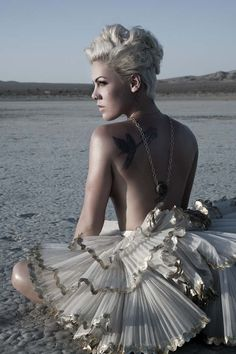 "P!nk - ""I've got a guardian angel tattooed on my shoulder.  She watches over me""  Awesome photo - vulnerable, feminine, strong."