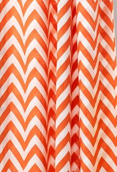 This shower curtain with its bold orange chevron pattern adds punch to a bathroom. About $30; Home Decorators Collection