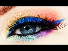 Rainbow Pin-Up Makeup Tutorial by Cora of Vintage Or Tacky using Makeup Geek's Poppy, Peach Smoothie, Untamed, Fortune Teller, Starry Eyed, Masquerade, Pegasus, and Fantasy eyeshadows and foiled eyeshadows.